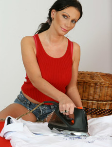 She Does Her Housework Them Plays with Her Big Boobs