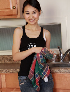 Exotic 30 Year Old Amber Thi from  Milfs30  Undresses in the Kitchen