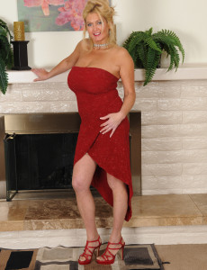Big Breasted and Elegant 47 Year Old Tahnee Taylor Pising by the Fireplace